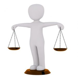 Man holding weighing scales